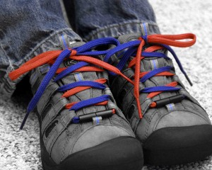 Shoes with colored laces for teaching kids how to tie
